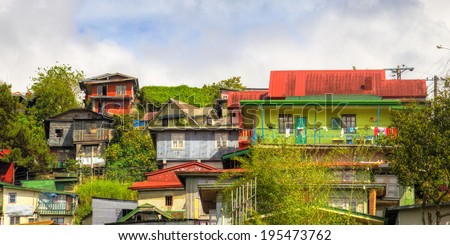 Residental structures on the hill tops of Baguio Cuty, Philippines - stock photo