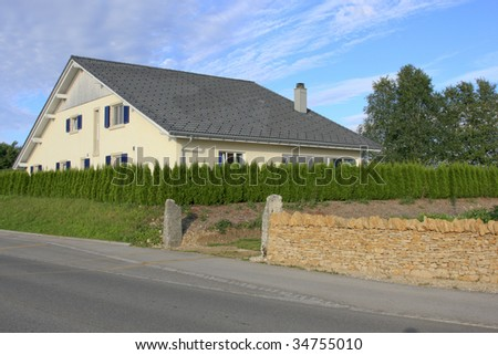 Residential building behind hedges - stock photo