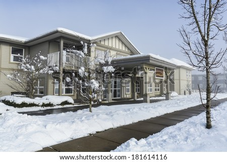 Residential building on snowy day in winter - stock photo