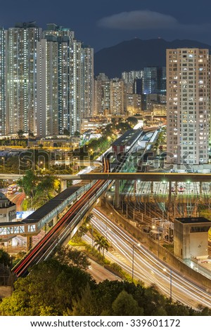 Residential buildings and highway in Hong Kong at night - stock photo