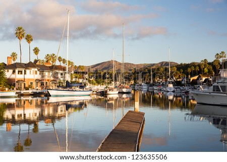 Residential development by water in Ventura California with modern homes and yachts boats - stock photo