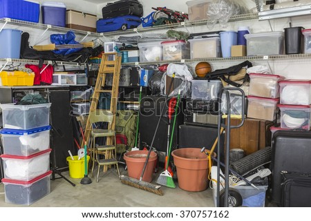 Residential garage full of junk and storage.  - stock photo