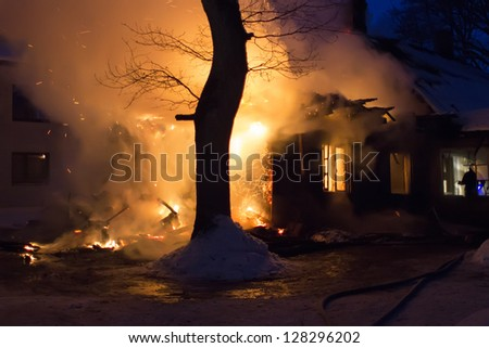 residential home on fire - stock photo