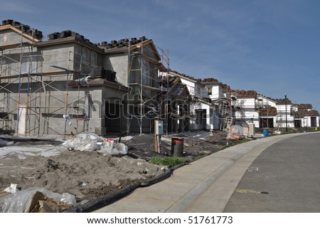 Residential Homes Under Construction with Blue Sky - stock photo