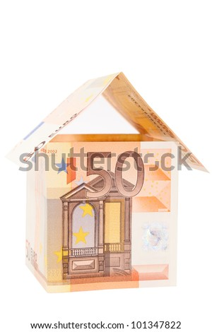 Residential house composed of folded euro banknotes isolated on white - stock photo