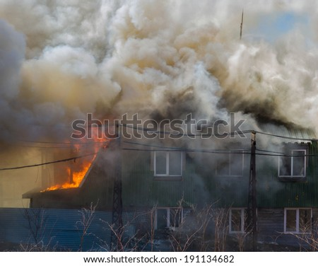 Residential house fire. - stock photo