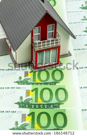residential house on banknotes, symbolic photo for home purchase, financing, building society - stock photo