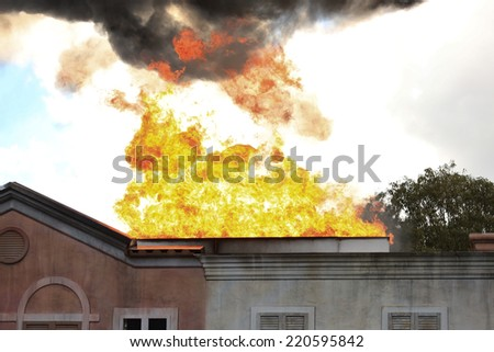 Residential House on Fire - stock photo