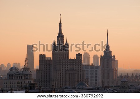 Residential house on Kudrinskaya Square and Ukraine hotel (Stalin skyscrapers) at morning in Moscow - stock photo