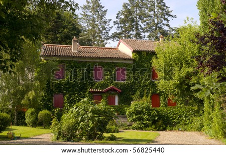 Residential house with red windows - stock photo