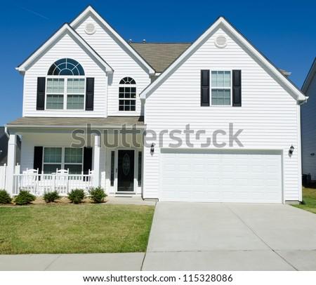 Residential house with white vinyl siding - stock photo