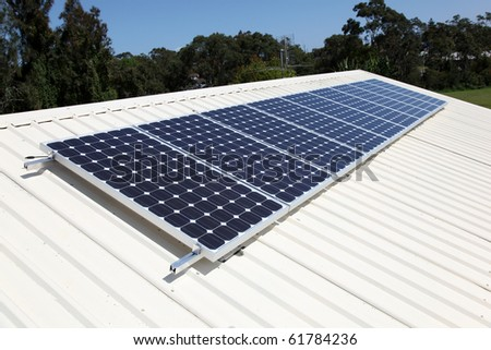 Residential roof top solar panel cells. Solar energy is becoming an important part of the energy mix. - stock photo