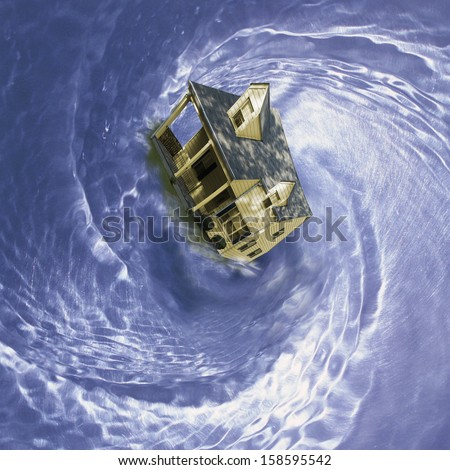 residential single family house spinning in whirlpool - stock photo