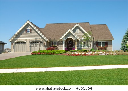 Residential Upscale American House - A residential suburban home in an upscale neighborhood in the summertime. - stock photo