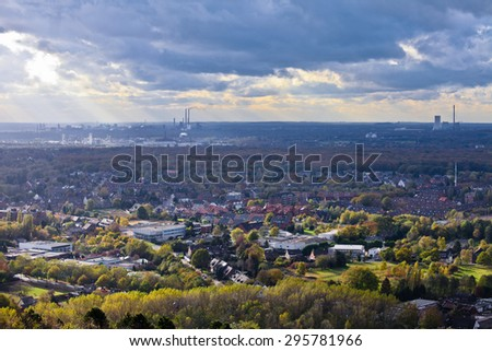 residential urban area of Oberhausen  Germany  Europe  with heavy industry of the Ruhr Area, Ruhrgebiet, in background - stock photo