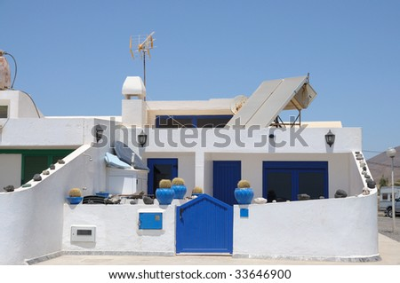 Residential white blue house on Canary Island Fuerteventura, Spain