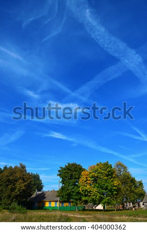 Residential wooden house under the blue sky, autumn in countryside - stock photo