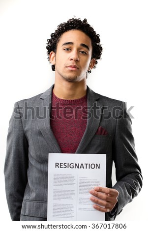 resignation sheet in young sad man's hand