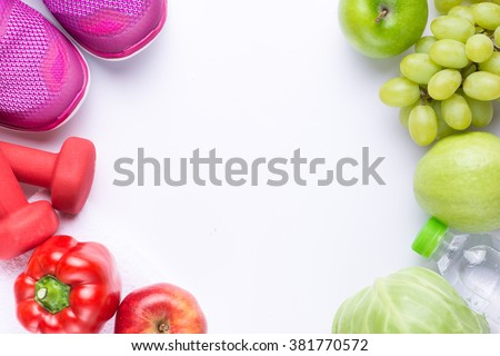 Resolutions eat healthy, lose weight and join gym, fresh fruits, dumbbells for fitness and tape measure, healthy lifestyle - stock photo