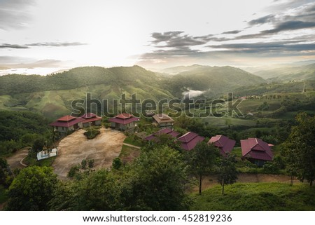 resort at mountain sunrise - stock photo