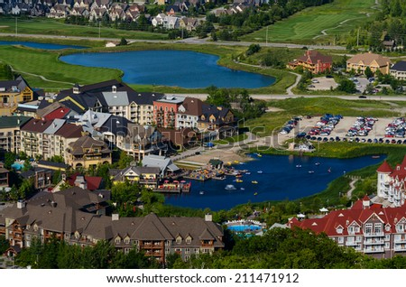 Resort buildings and ponds in Blue Mountain village in Collingwood, Ontario - stock photo