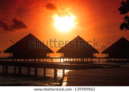 resort maldivian houses - stock photo