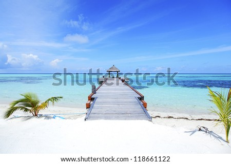 resort maldivian houses in blue sea - stock photo