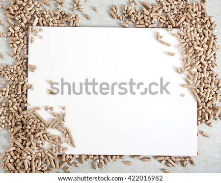 Resource. Pellets on the table - stock photo
