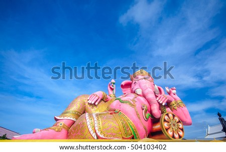 Respect and worship with the most beautiful of large statue pink ganesha at Samanrattanaram temple  in thailand on wonderful sky,copy space