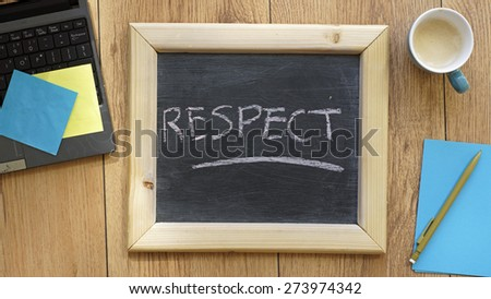 Respect written on a chalkboard at the office - stock photo