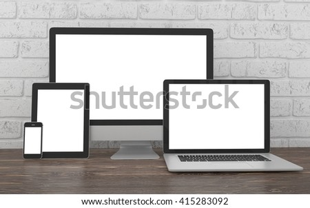 Responsive mockup screen. Monitor, laptop, tablet, phone on table in office. 3d rendering. - stock photo