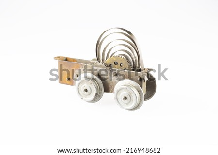 Rest of an old clockwork toy locomotive on a white background - stock photo