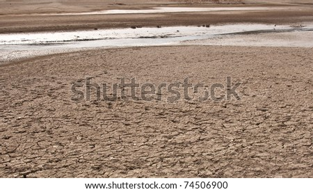 Rest of the Water on bottom of the dried lake - stock photo