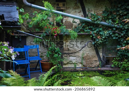 rest place at a shed with little pond in front of it - stock photo