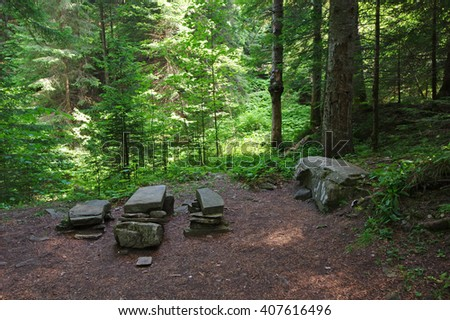 Rest place from stones in the forest. - stock photo