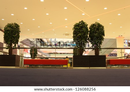 rest zone with sofas and trees in mall - stock photo