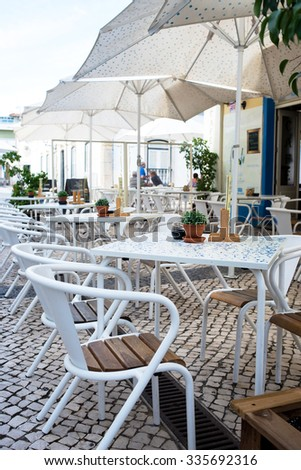 restaurant air cafe chairs with tables in Portugal - stock photo