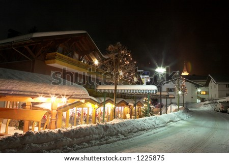 Restaurant and streets in Kirchberg, Germany.  Movement on people sitting in the restaurtant