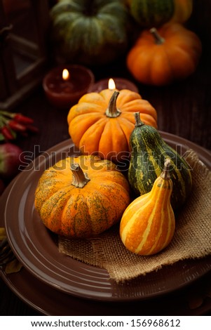 Restaurant autumn table setting. Thanksgiving holiday Place setting autumn decoration. - stock photo