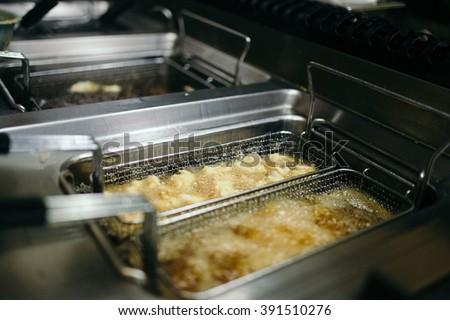 Restaurant deep fryer - stock photo