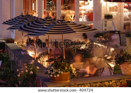 Restaurant dining outside in the summer at night. Horizontal. - stock photo