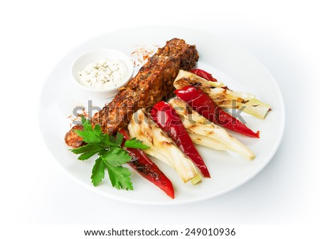 Restaurant food - grilled salmon steak with peppers and onion shallot isolated at the white background - stock photo
