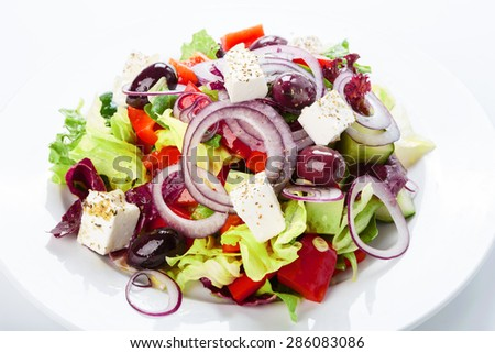 Restaurant healthy food, diet and vegetarian nutrition - greek salad with onion rings, closeup - stock photo