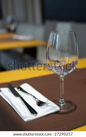 Restaurant interior, focus is on the glass