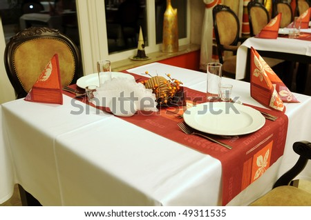 Restaurant interior with served tables ready for guests and the party. - stock photo
