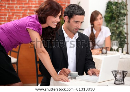 Restaurant manager going over accounts - stock photo