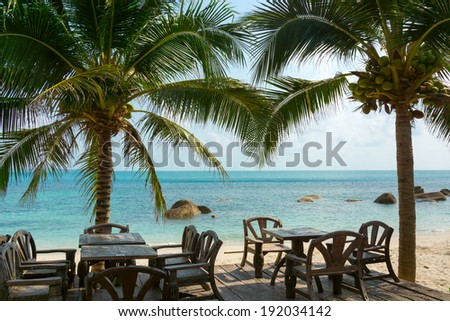 Restaurant on the beach in tropical resort - stock photo