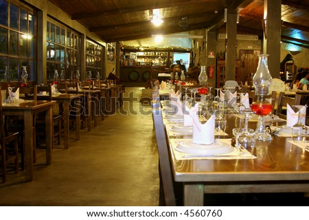 restaurant room with table set and rustic decoration