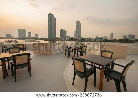 restaurant seats and tables near the river, restaurant interior - stock photo