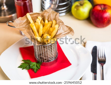 Restaurant serving dish for child`s menu - stick potatos roast free on white background - stock photo